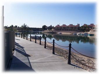Front walkway along water to English Village and London Bridge - Lake Havasu City Condo Rental